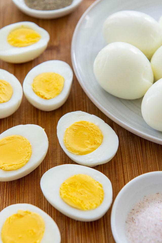 Hard Boiled Eggs - Sliced in Half on Wooden Board
