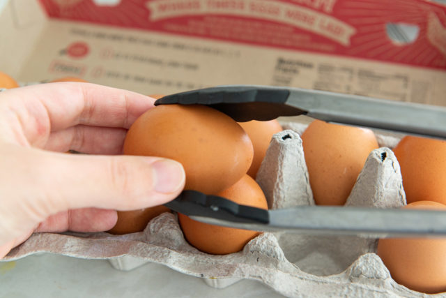 Holding a Brown Vital Farms Egg in Nylon Tongs