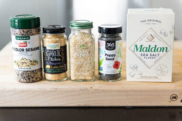 Sesame Seeds, Dried Garlic Flakes, Dried Onion Flakes, Poppy Seeds, and Maldon Sea Salt Flakes in Packages