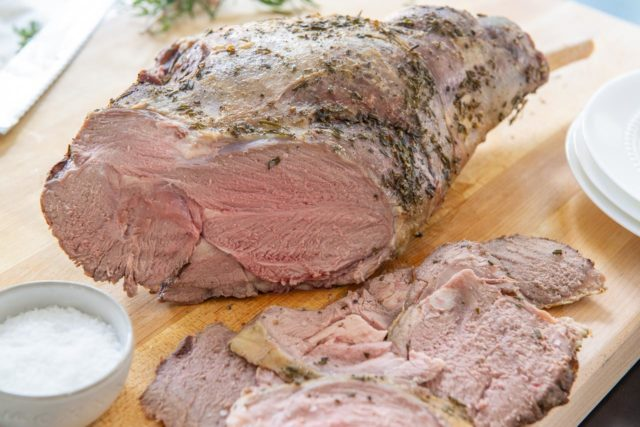 Leg of Lamb Recipe - Shown on a Wooden Cutting Board Sliced