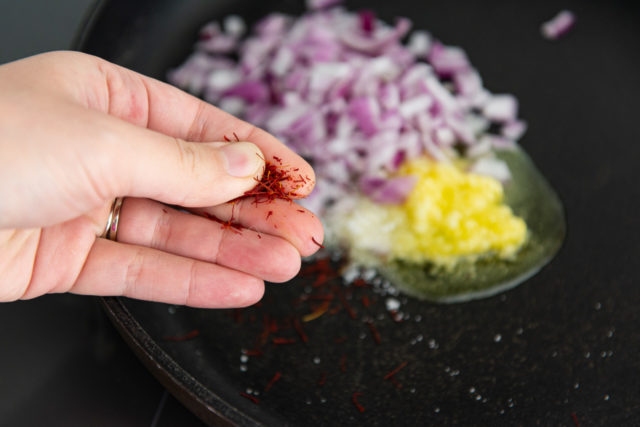 Crumbling Saffron Threads in Fingers