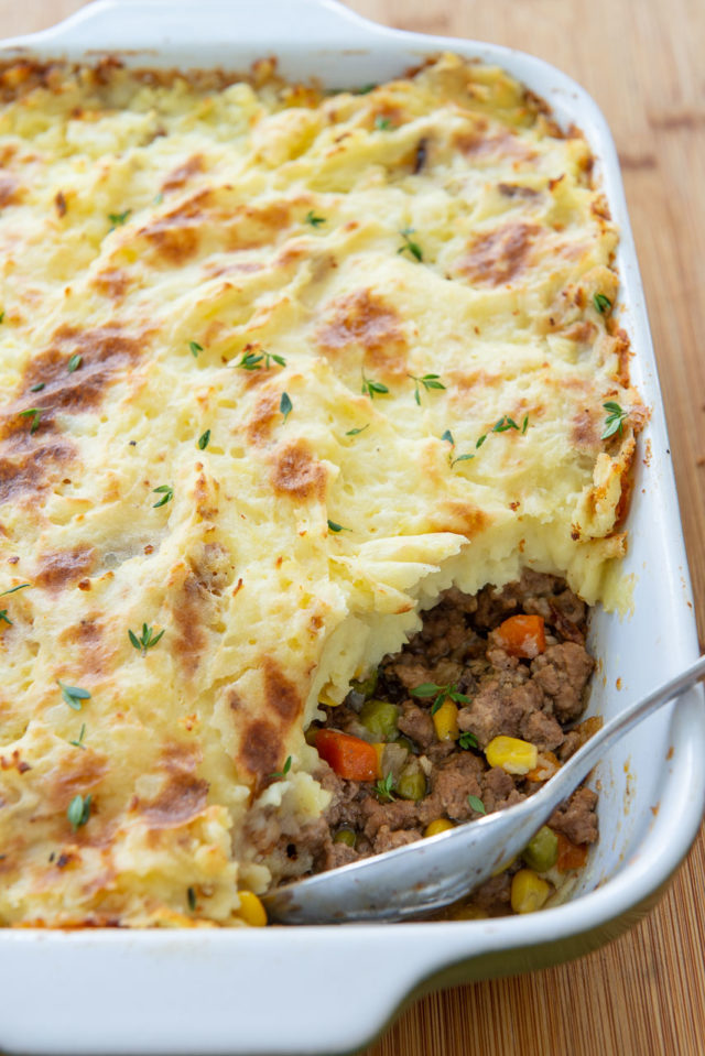Shepherd's Pie Recipe - Shown in a Green 8x11 Casserole Dish with Serving Spoon