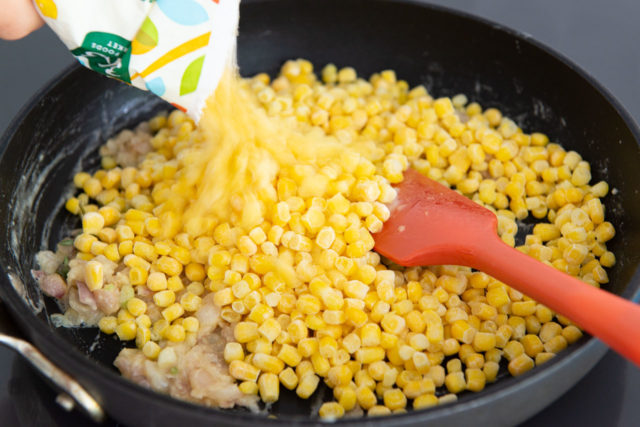 Pouring Frozen Corn into Skillet with Shallots and Butter