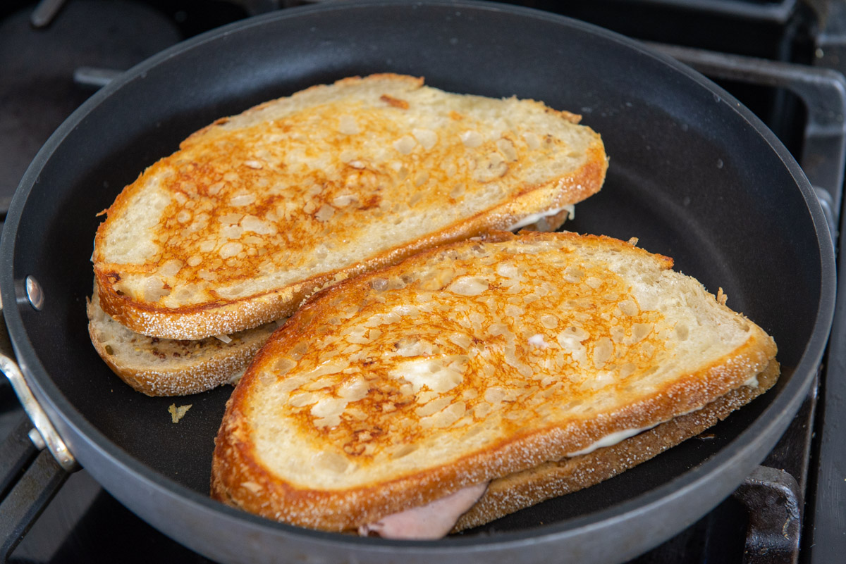 French Grilled Cheese in a Nonstick Skillet Frying Until Golden