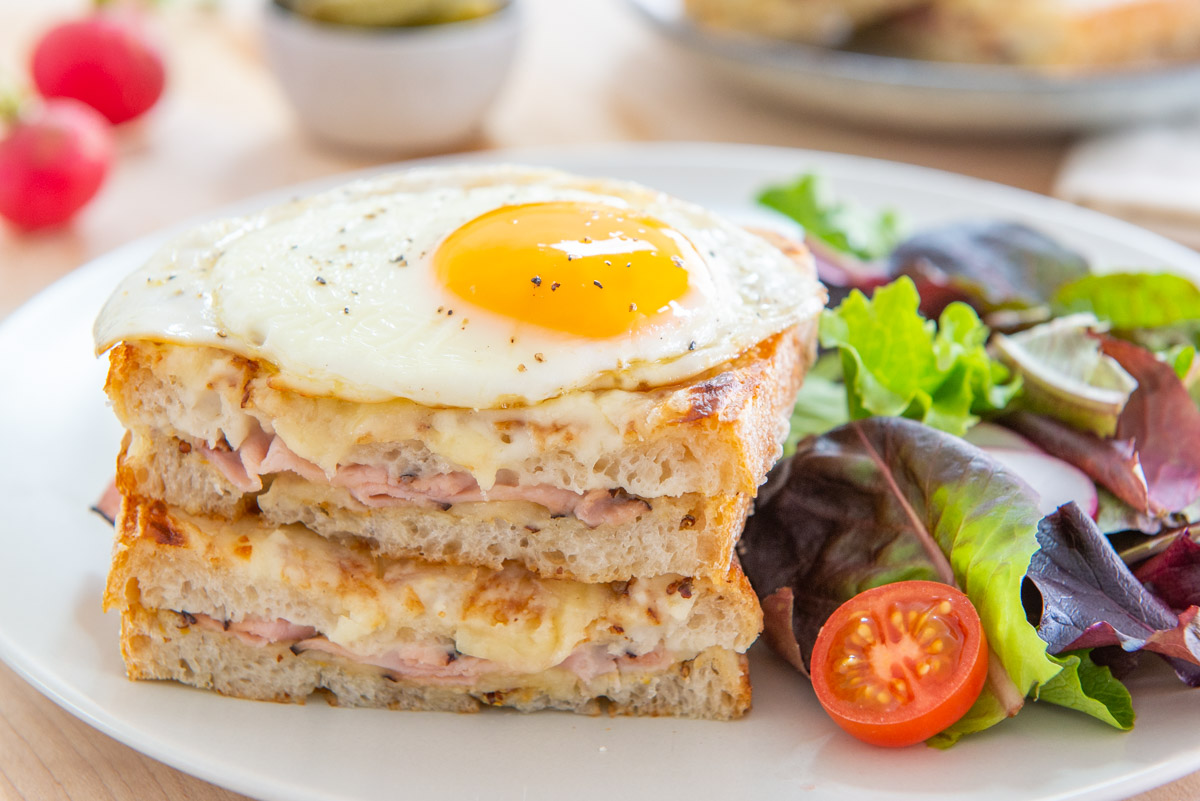 Croque Madame Recipe Served on Gray Plate with Side Salad