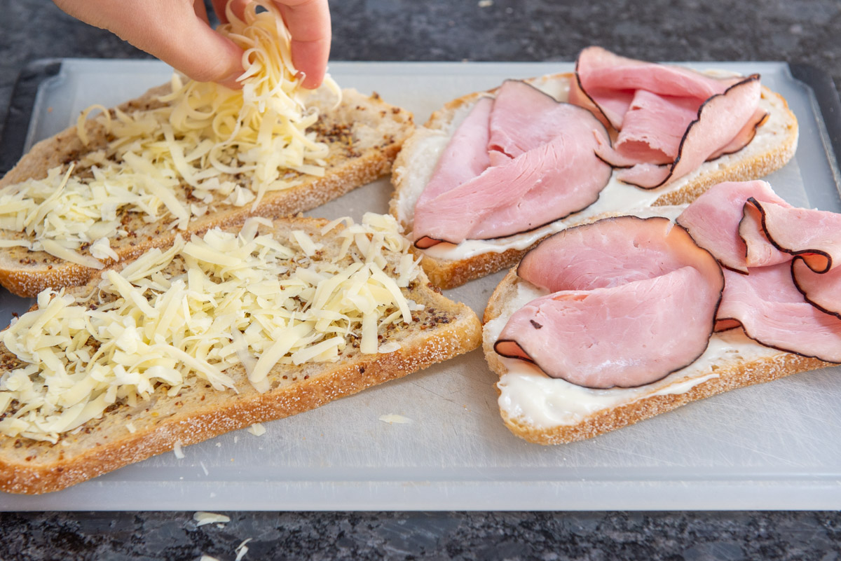 Added Gruyere Cheese to Bread Slices on Board