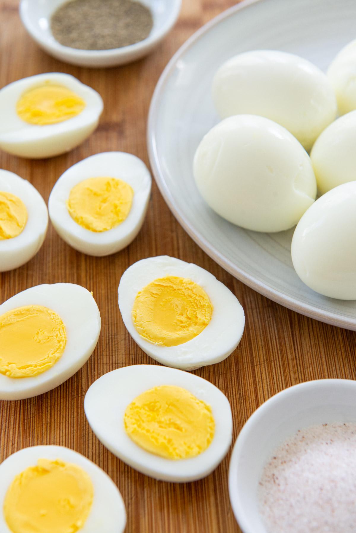 Hard Boiled Eggs Sliced in Half on Wooden Board