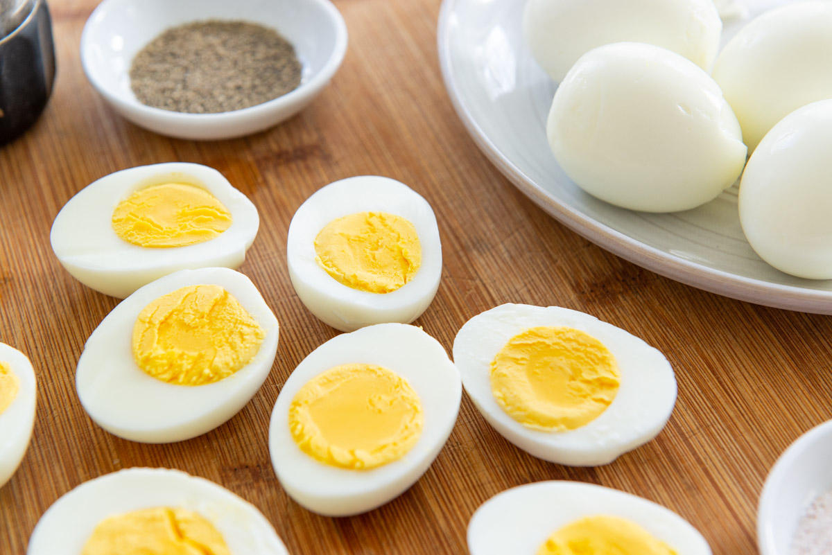 Sliced Hard Boiled Eggs on a Wooden Board