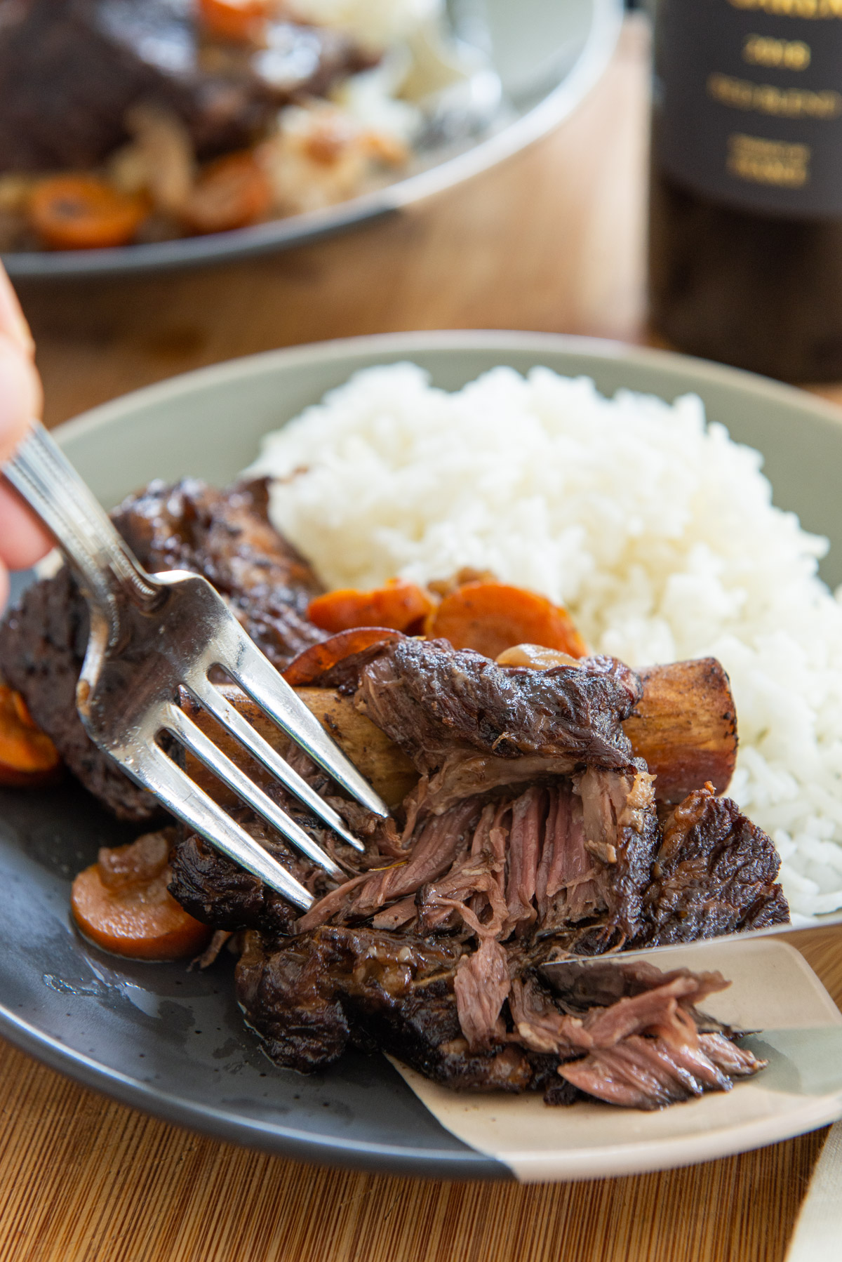 Slow Cooker Short Ribs Plated with White Rice and Fork and Knife Showing Texture