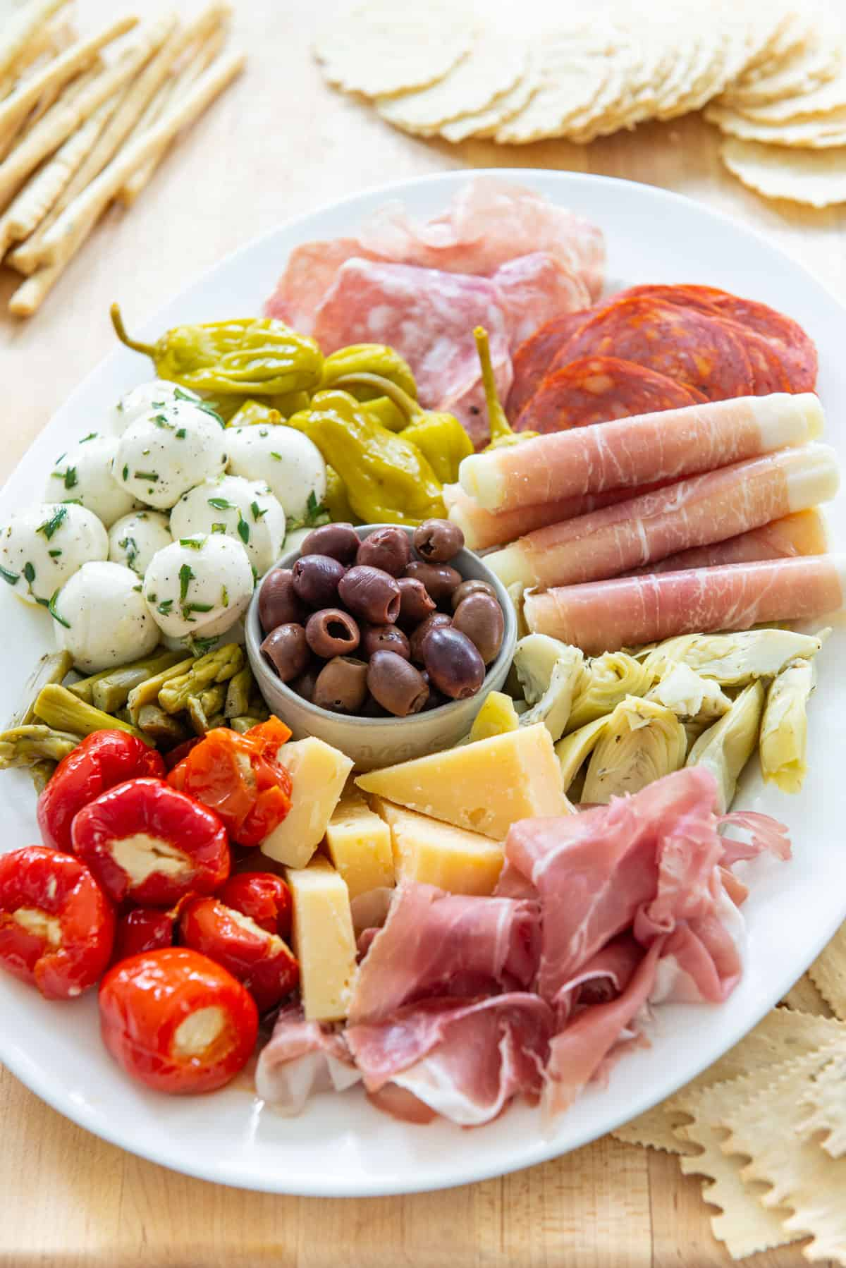 Antipasto Platter on a Wooden Board with Crackers