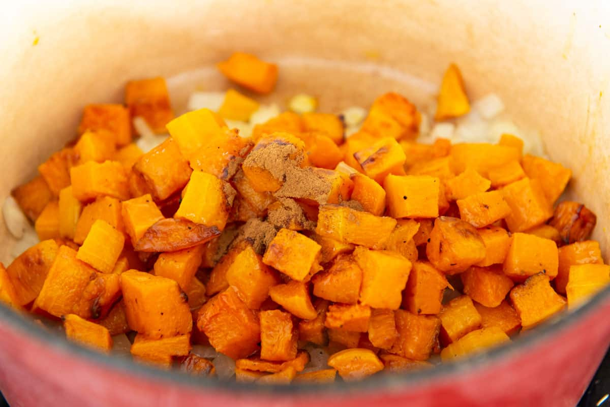 Cubes of Roasted Butternut Squash and Cinnamon Added to Pot