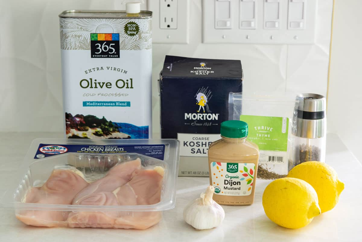 All the Ingredients Needed for Grilled Chicken Marinade, Including Olive Oil and Lemon