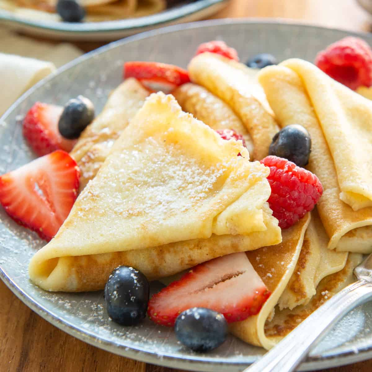 Homemade Crepes On Blue Plate with Berries