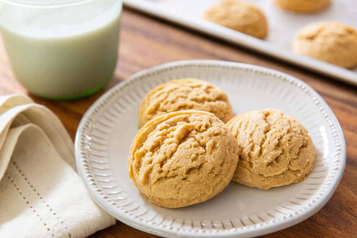 Peanut Butter Cookie Recipe Presented on White Dish with milk in background