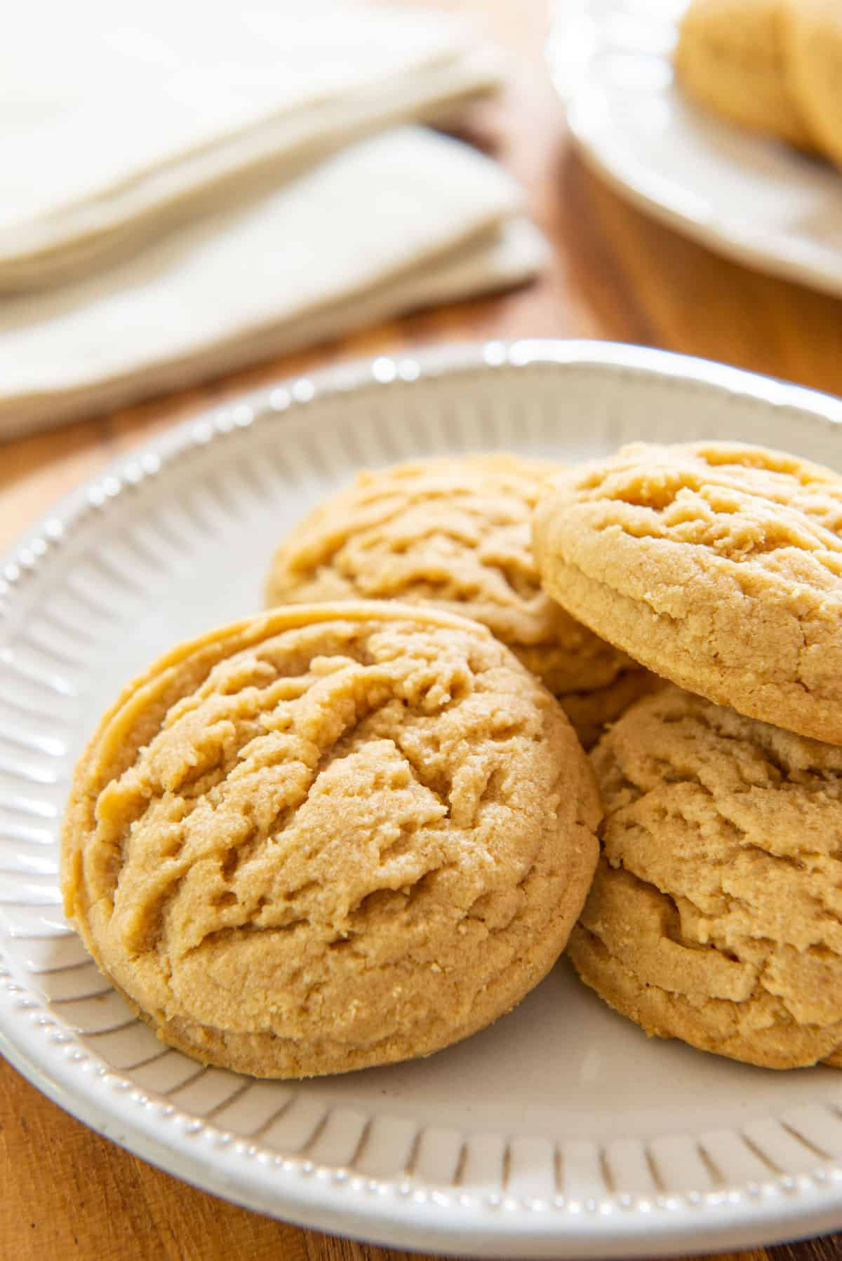 Peanut Butter Cookies On a White Dish with 4 Pieces