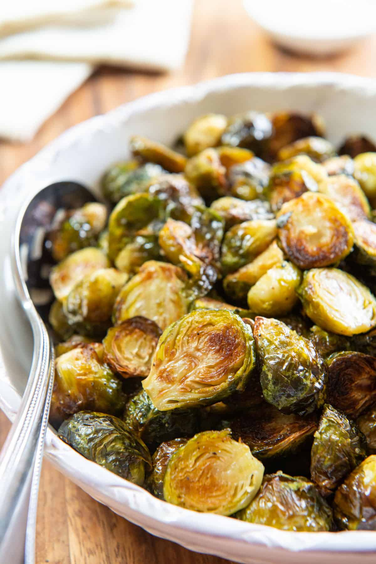 Roasted Brussel Sprouts In a White Bowl with Spoon