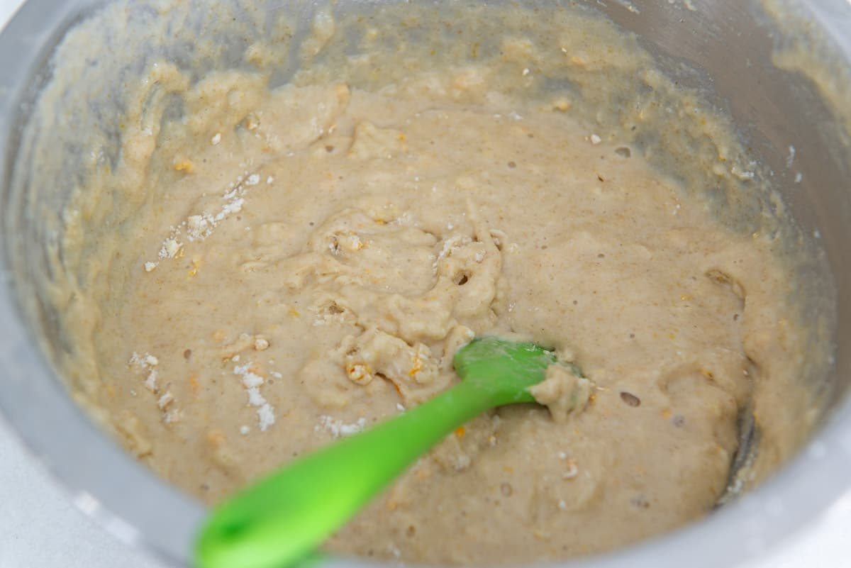 The stirred batter in a stainless steel bowl