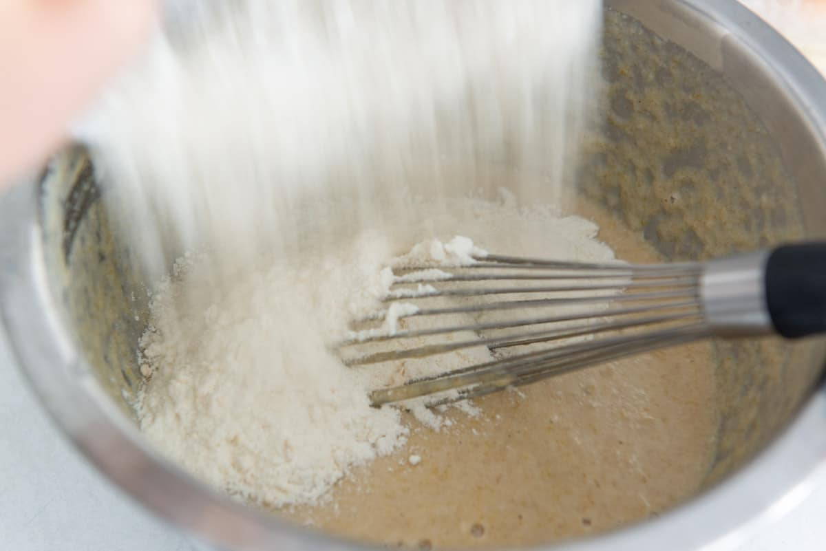 Pouring the dry ingredients into the wet ingredients