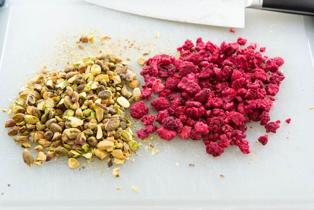 Chopped Pistachios and Freeze Dried Raspberries on Cutting Board